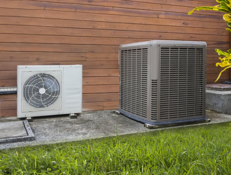 Air conditioning heat pumps on the side of a house